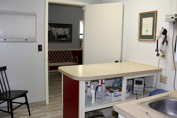 One of the exam rooms decorated white and red